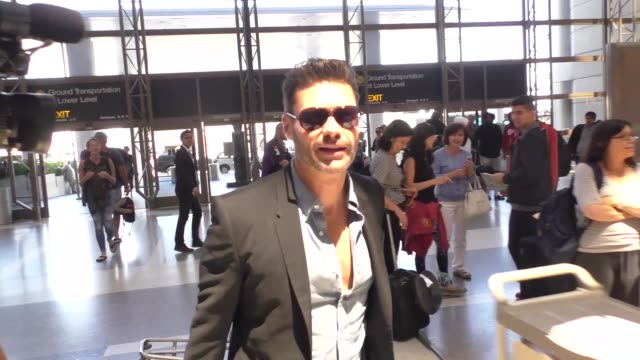 interview ryan seacrest talks about the kardashians while departing at lax airport in los angeles in celebrity sightings in los angeles - ryan seacrest stock-videos und b-roll-filmmaterial