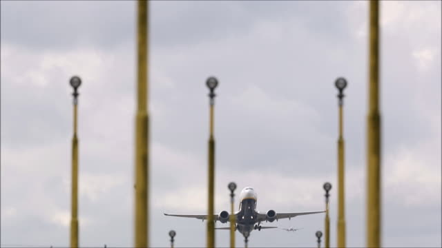 a ryanair plane departs from stansted airport on october 20 2016 in london england ryanair has reduced its profit forecast following the drop in the... - ライアンエアー点の映像素材/bロール
