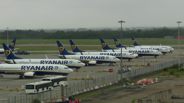 ryanair planes at stansted airport filmed on day uk government readvised against all but essential travel to spain during coronavirus pandemic - reportage stock videos & royalty-free footage