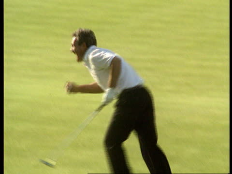 ryder cup; 1989 england sutton coldfield the belfry bv golfer puts and ball into hole golfer celebrates and hugs others as cheering heard sof tony... - pgaイベント点の映像素材/bロール