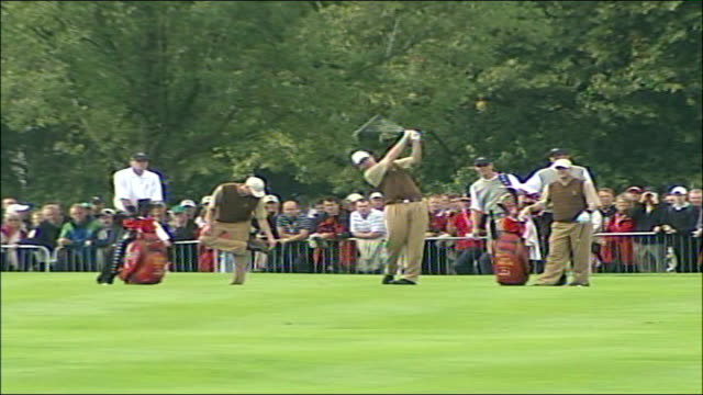 stockvideo's en b-roll-footage met lead up to tournament colin montgomerie next paul casey pull montgomerie along pan pull out crowd of onlookers members of american team practising... - 2006