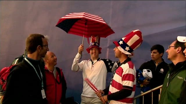 day 1; us fans dressed in us flag costumes and hats europe fan dressed in union jack suit and bowler hat vox pop - day 1 stock videos & royalty-free footage