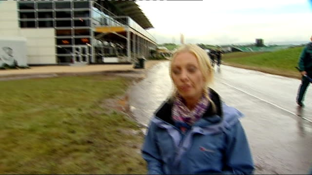 day one / play disrupted by rain EXT Ryder Cup clock and reporter to camera beneath