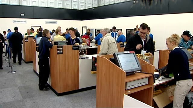 day one / play disrupted by rain people paying at cash tills in shop - pga event stock videos and b-roll footage