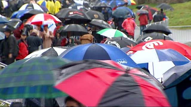 day one / play disrupted by rain sea of umbrellas along at course - pga event stock videos and b-roll footage
