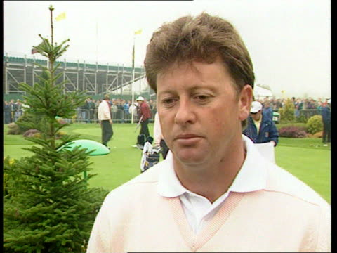 birmingham: the belfry: faldo chatting to severiano ballesteros as prepare to practise cms side ian woosnam swinging club in practice cms ian woosnam... - golf swing stock videos & royalty-free footage