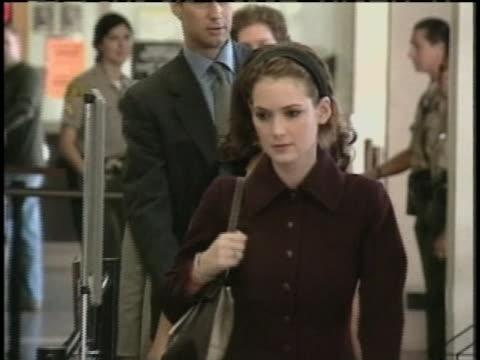 ryder walks down hallway as flashbulbs go off - winona ryder stock videos & royalty-free footage