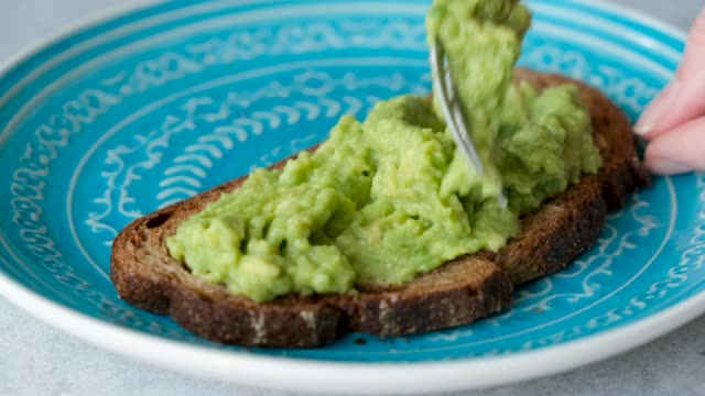 rye bread with avocado mash - towel stock videos & royalty-free footage