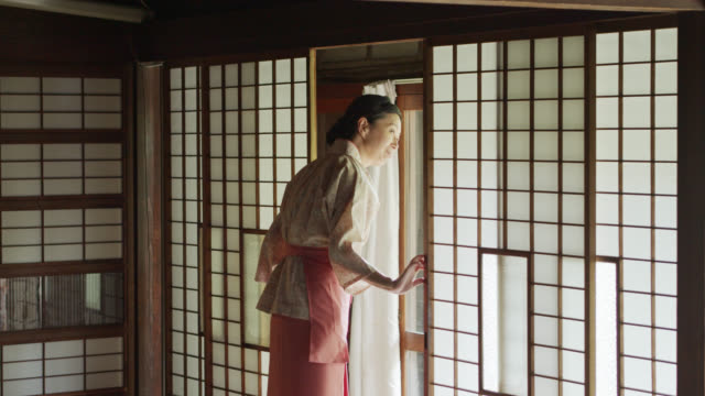 Ryokan Hostess Looking Out Into Corridor