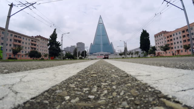 ryugyong hotel from street-level in pyongyang, north korea - capital cities stock videos & royalty-free footage