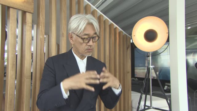 ryuichi sakamoto on the climate, nature and how it effects his music at palazzo del cinema on september 03, 2017 in venice, italy. - 74th venice film festival stock videos & royalty-free footage