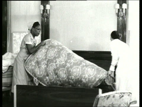 B/W 1930's 2 black women flipping mattress over on bed / SOUND