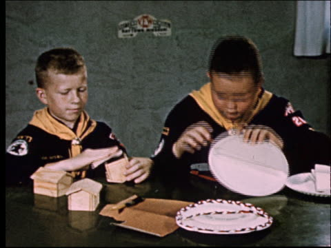 1950's 2 boys in cub scout uniforms making crafts - cub scout stock videos and b-roll footage
