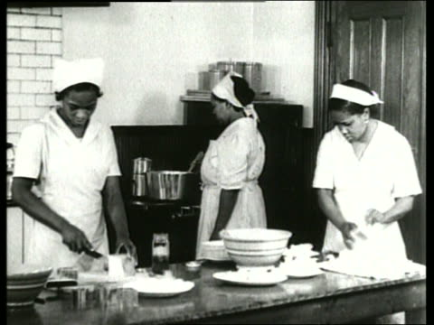 b/w 1930's 3 black women cooking in kitchen / sound - home economics stock videos & royalty-free footage
