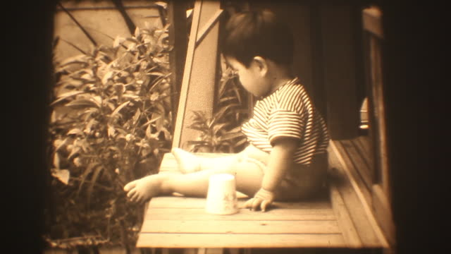 60's 8mm footage - Baby boy play toy at home