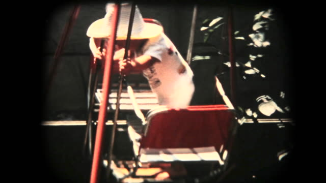 vídeos de stock e filmes b-roll de 60's 8mm footage - baby boy play with swing - memorial