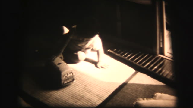 60's 8mm footage - baby boy play with xylophone and toy car - showa period stock videos & royalty-free footage