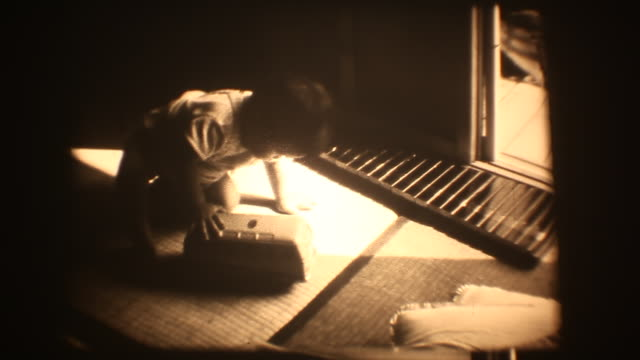 60's 8mm footage - Baby boy play with xylophone