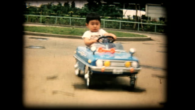 60's 8mm footage - boy playing with a toy car - boys stock videos & royalty-free footage