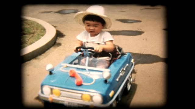 60's 8mm footage - boy playing with a toy car - archival stock videos & royalty-free footage