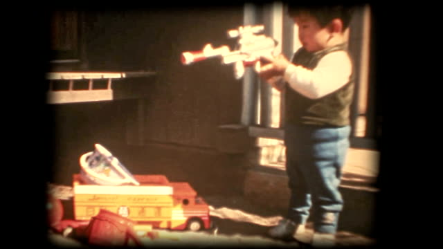 60's 8mm footage - Boy playing with a toy gun