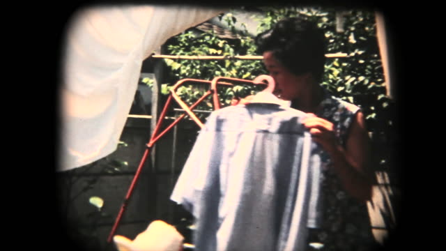 60's 8mm footage - hanging clothes after laundry - chores stock videos & royalty-free footage