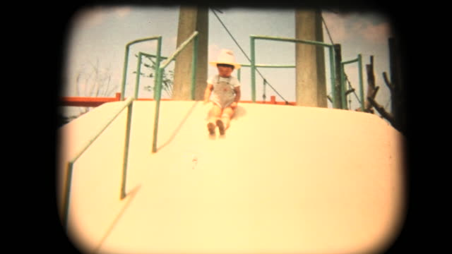 60's 8mm footage - having fun while sliding - emotion stock videos & royalty-free footage
