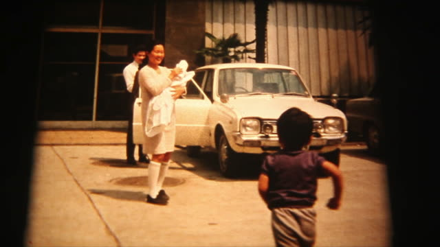 60's 8mm footage - mother and newborn baby going to home - di archivio video stock e b–roll