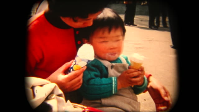 60's 8mm footage - mother and son eating an ice cream - archival stock videos & royalty-free footage