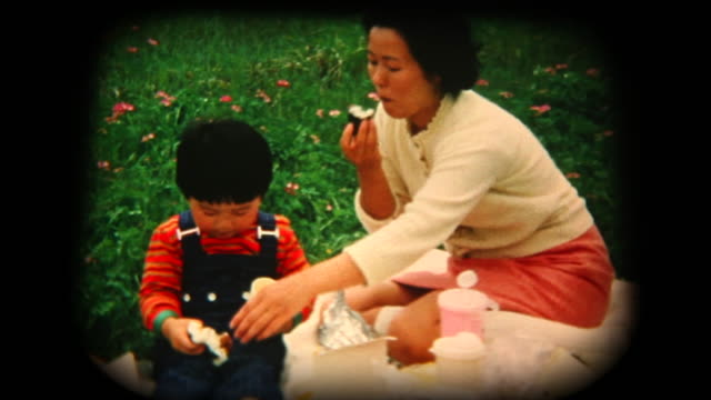 60's 8mm footage - mother and son having a picnic - showa period stock videos & royalty-free footage