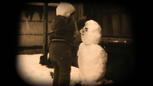 60's 8mm footage - playing with a snowman - archival stock videos & royalty-free footage