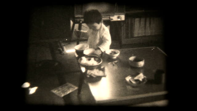 60's 8mm footage - young boy eating with spoon