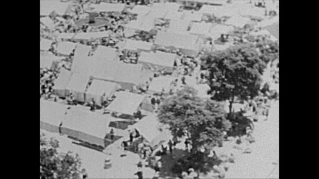 1940's Aerial POV of Indigenous street market in Guatemala