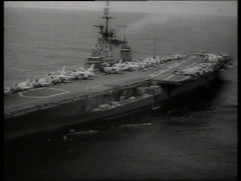 s aerial over aircraft carrier on ocean / vietnam / sound - aircraft carrier stock videos & royalty-free footage