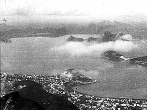 vídeos de stock, filmes e b-roll de 1920's - aerials of rio de janiero, pan of sao paulo - 1920