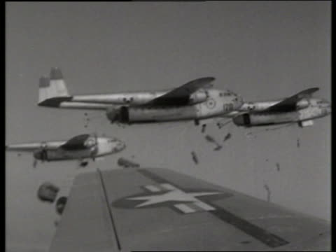 b/w 1950's airplane point of view parachutes drop from airplanes / c119 boxcar / korea / no - c119gs stock videos & royalty-free footage