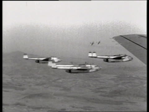 b/w 1950's airtoair of military airplanes flying / c119 boxcar / korea / no - korean war stock videos & royalty-free footage
