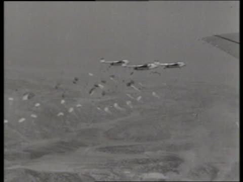 b/w 1950's airtoair parachutes dropping from airplanes / c119 boxcar / korea / no - c119gs stock videos & royalty-free footage