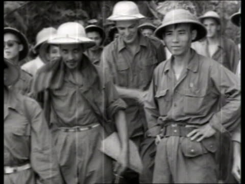 B/W 1970's Asian and US soldiers shaking hands / Vietnam / NO