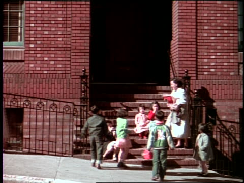 1950's asian children and woman in front of building / chinatown, san francisco - chinatown stock videos & royalty-free footage
