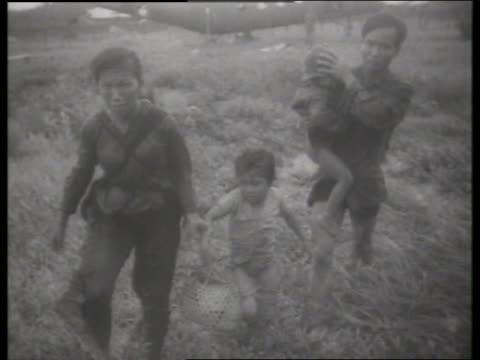 s asian family walking in grass / vietnam / sound - vietnam war stock videos & royalty-free footage