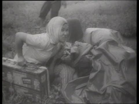 s asians huddling in grass / vietnam / sound - vietnam war stock videos & royalty-free footage