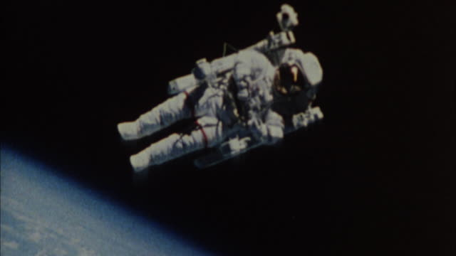 1980's ms astronaut performing untethered space walk / united states - astronaut stock videos & royalty-free footage