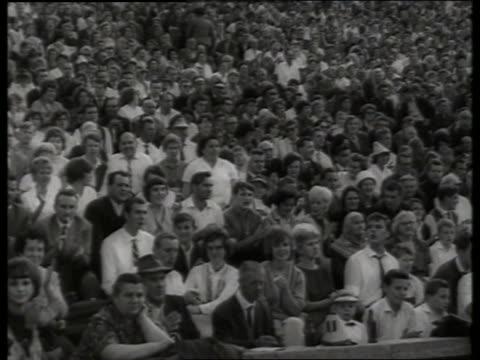 b/w 1960's audience clapping in crowded stadium / west berlin - 西ドイツ点の映像素材/bロール