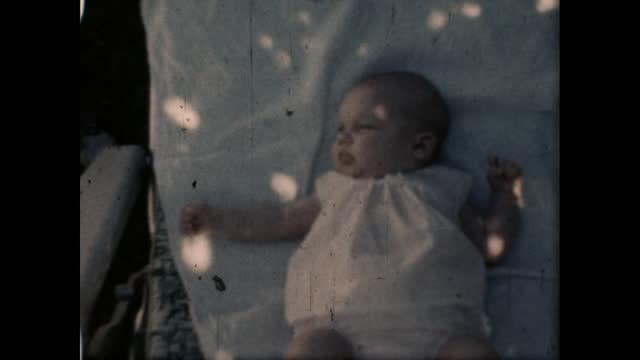 1960's - baby lying in chair outside - film leader stock videos & royalty-free footage