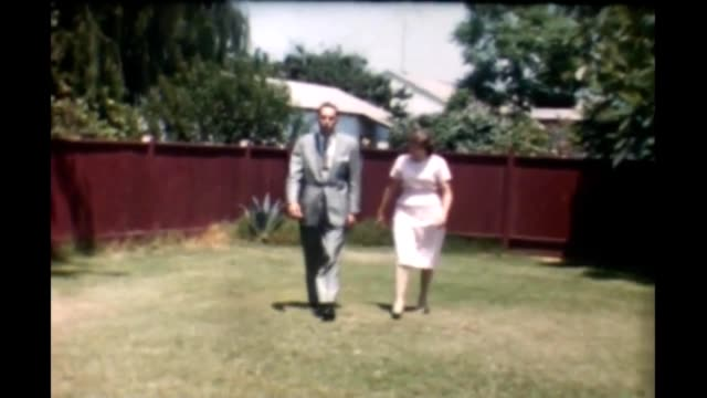 1950's backyard couple - hair length stock videos and b-roll footage