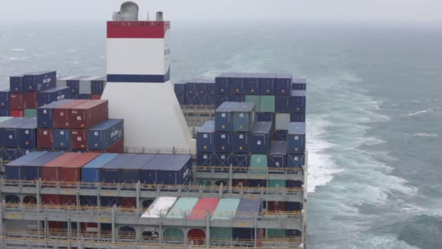 sa's benjamin franklin container ship breaks waves as the vessel sails from xiamen to guangzhou china on sunday jan 31 2016 - benjamin franklin stock videos & royalty-free footage