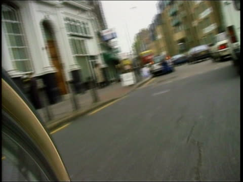 MP's bicycle allowance ITN London Westminster EXT i/c Anne Campbell MP waiting with bicycle at traffic lights View from camera attached to wheel of...