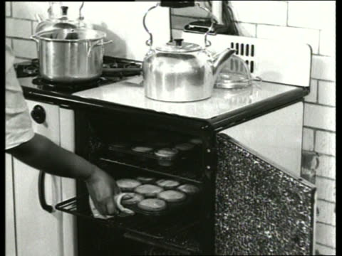 b/w 1930's black woman taking muffins from oven / sound - muffin stock videos and b-roll footage