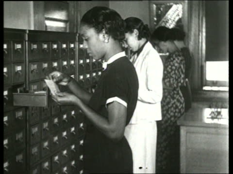 b/w 1930's black women filing in card files in office / sound - library stock videos & royalty-free footage